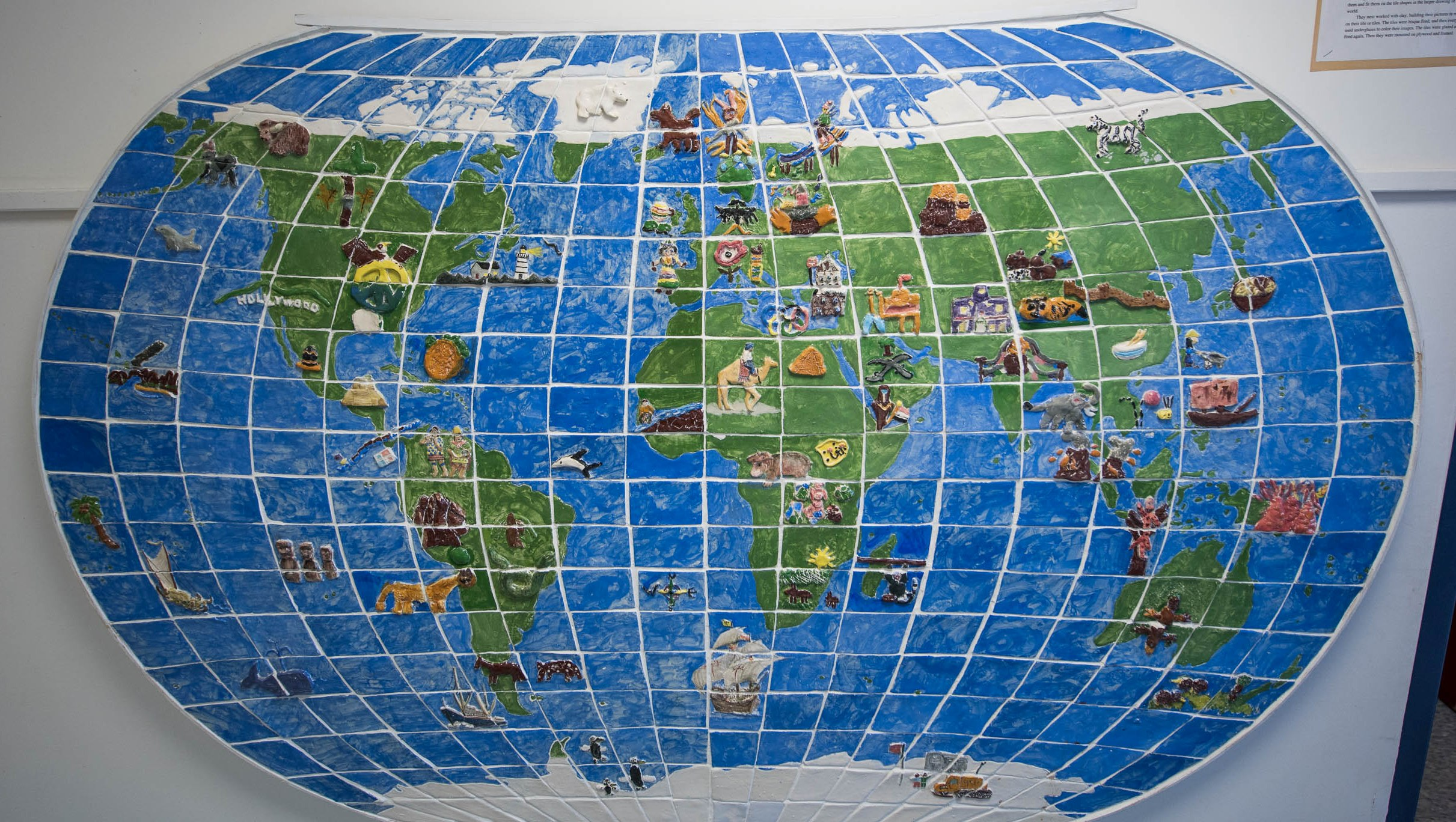image of ceramic map of world on wall